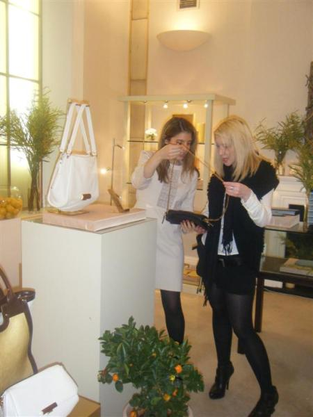 Press Officer Bianca showing the new collections to Harriet from Elle